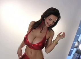 Denise Milani in a red dress