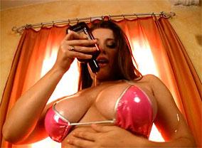 Erica in pink bikini pours oil