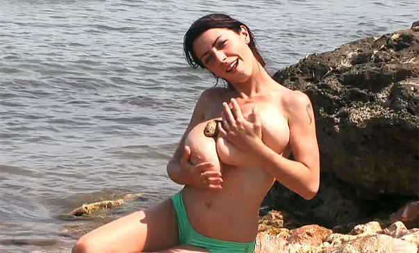 Busty Anya naked at the beach